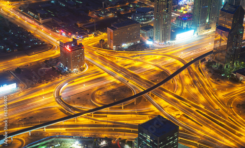 Aerial view of motorway in modern city at night