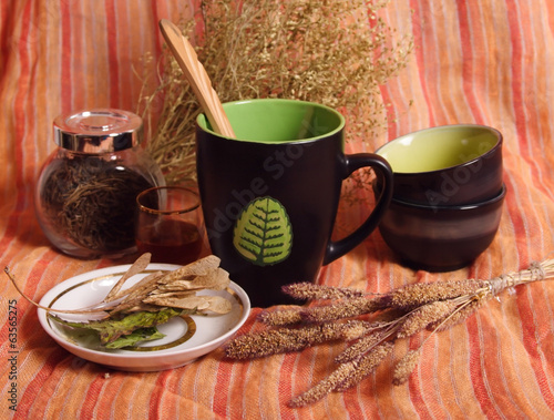 Still life with dried herbs, cups, bowls
