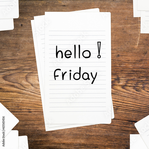 Hello Friday on paper and wood table desk