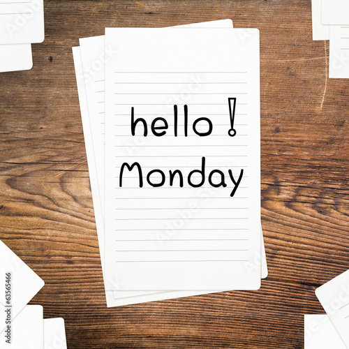 Hello Monday on paper and wood table desk
