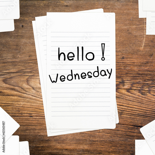 Hello Wednesday on paper and wood table desk