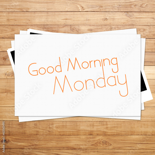 Good Morning Monday on paper and Brown wood plank background