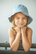 smiling little girl in cap