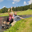 Couple Enjoying Summer Sledge