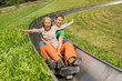 Couple Enjoying Alpine Coaster Luge