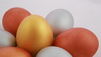 Golden easter eggs isolated over white background