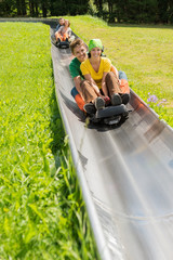 Happy Couples Enjoying Alpine Coaster Luge