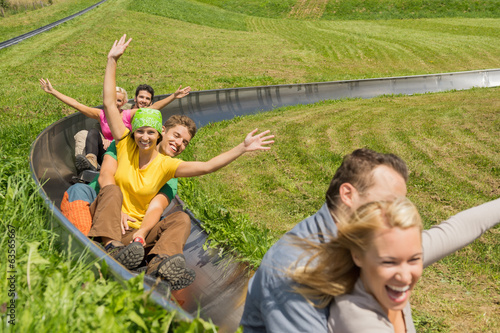 Excited Couples Enjoying Alpine Coaster Luge