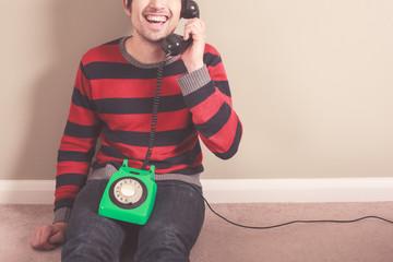 Happy man on the telephone