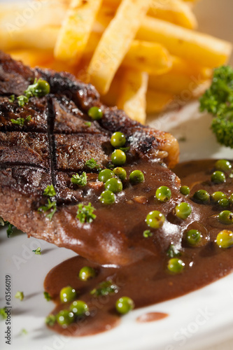 steak, a piece of beef steak with pepper sauce