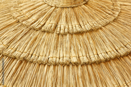 straw beach umbrella close-up