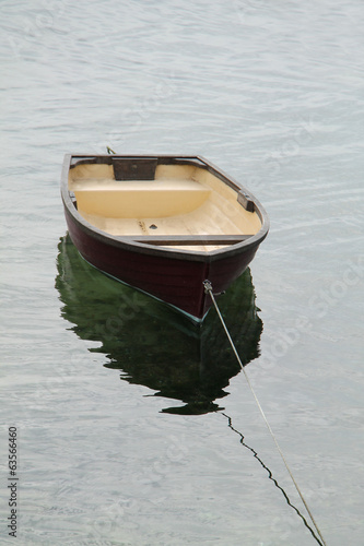 A Small Rowing Boat Tethered to a Rope.