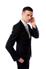 Handsome businessman talking on his mobile phone