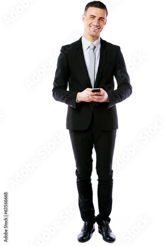 Happy businessman standing with phone over white background