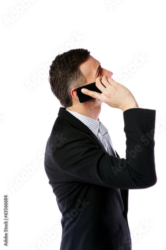 Side view portrait of a businessman talking on the phone
