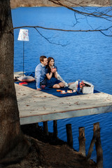 couple sitting on terrace near the water
