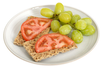 Rye Crispbread Crackers with Tomatoes and Grapes