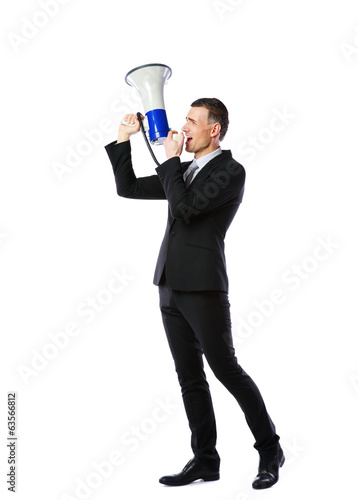 businessman yelling through megaphone