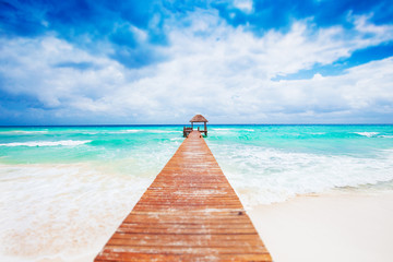 Tropical Beach with jetty. Mexico. Riviera Maya.