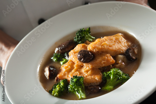 Chinese food, noodle with salmon mushroom and broccoli