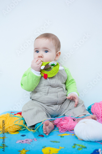 Cute baby playing with knitting