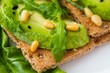 Crispbread with avocado and pine nuts