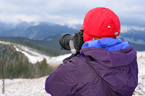 Tourist on winter walk in mountains
