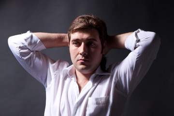 man posing in white shirt