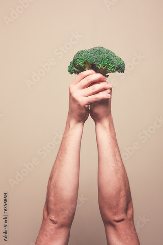 Holding broccoli