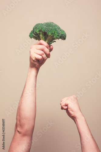 Holding broccoli in the air