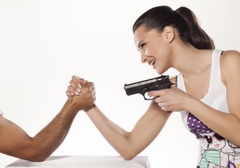 girl wrestles hand with men and use a gun
