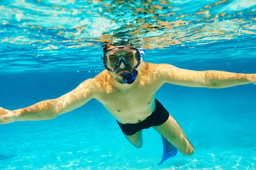 Man with mask snorkeling