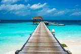 Fototapety Beautiful beach with water bungalows