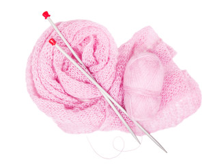 Pink  moher, knitting needlesis and pink knitted linen