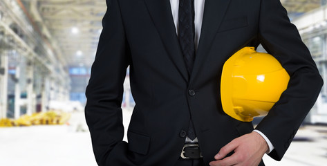 An engineer with a yellow cap