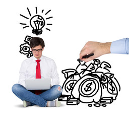 Sitting businessman with laptop and a concept of ideas and money