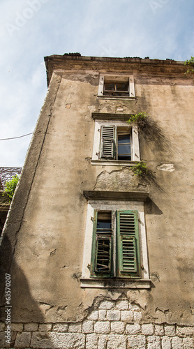 Broken Old Building in Kotor with Green Shutters