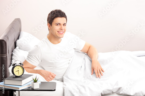Man lying in his bed at home