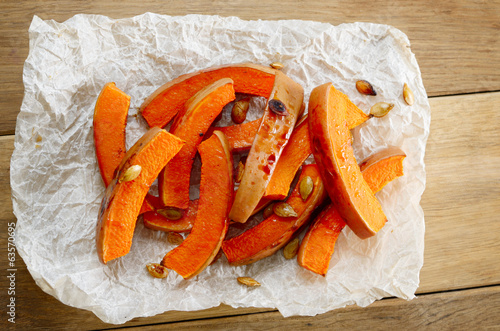 Pumpkin slices on baking paper