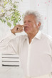 Senior man sneezing because suffering from allergy of pollen
