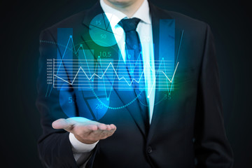 Businessman holding chart hologram projection