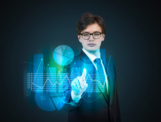 Businessman pointing out to the hologram graph