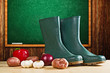 Rubber boots and various vegetable