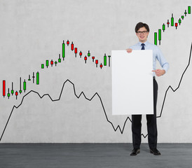 Businessman holding a placard. forex chart background.