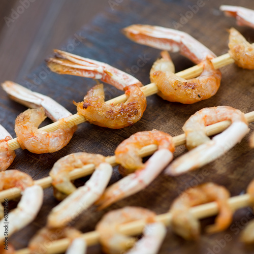 Close-up of grilled shrimp kebabs, studio shot
