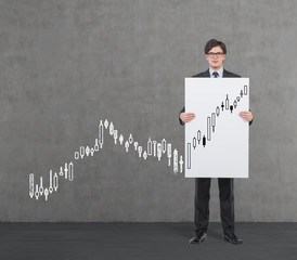 A businessman holding a poster with forex quotations