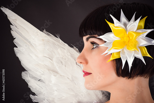 beautiful woman with a flower on the head and angel wings