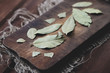 Vintage wooden cutting board with bay leaves, horizontal shot