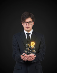 businessman holding lightbulb in hands. A concept of new ideas.