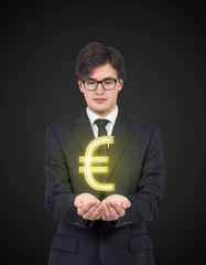 Businessman holding Euro sign